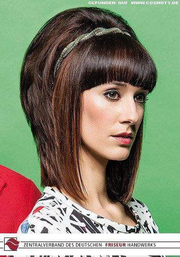 Seventies-Look mit viel Volumen zum Haarreif
